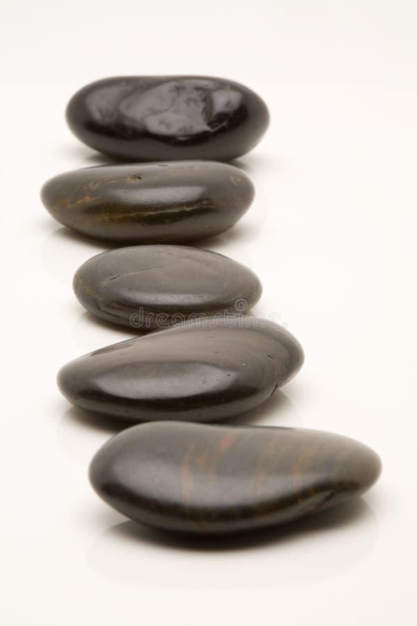 小卵石向禅宗扔石头 库存图片