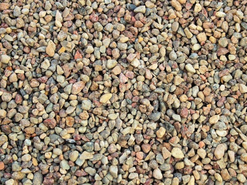 小卵石温暖颜色纹理背景 免版税库存照片