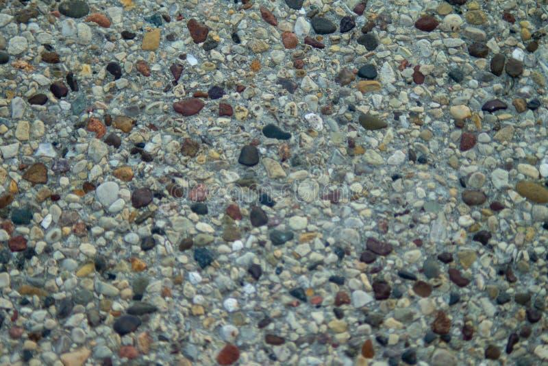 小卵石的图象在混凝土的 免版税库存图片