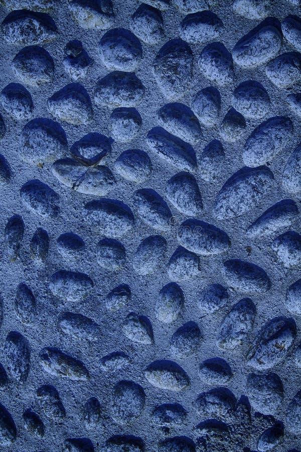 小卵石的蓝色尼斯背景图象,圆的岩石纹理 免版税库存图片