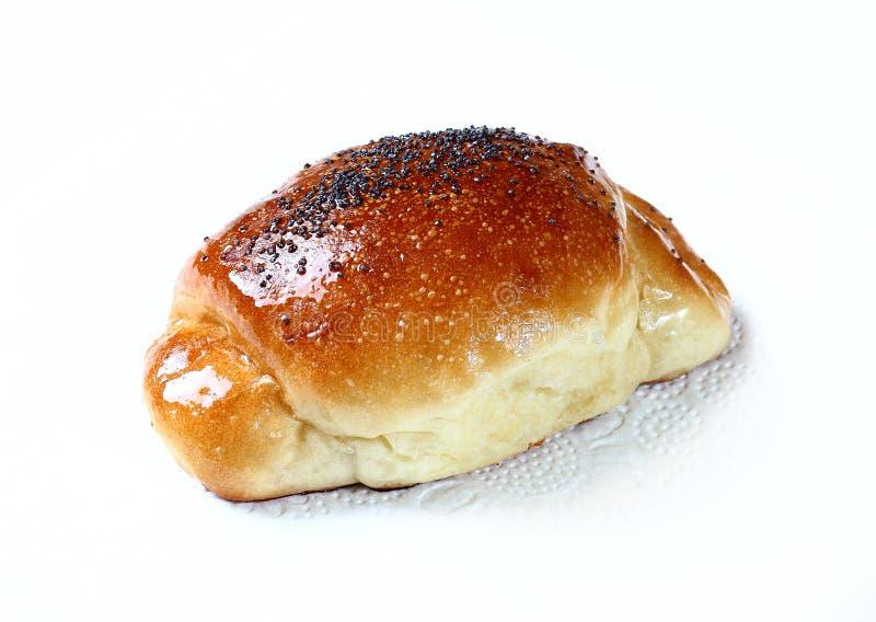 小圆面包被隔绝的白色背景 库存照片