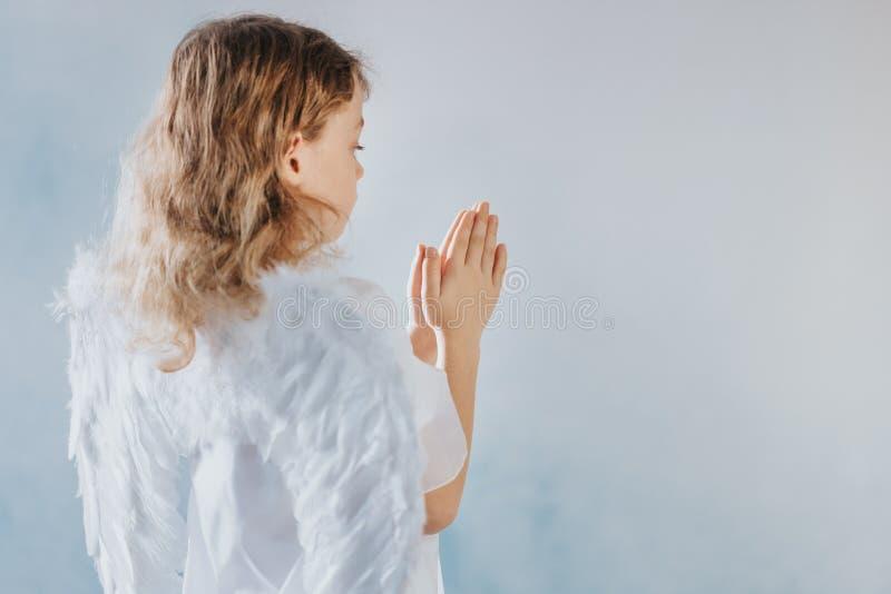 小天使祈祷 免版税图库摄影