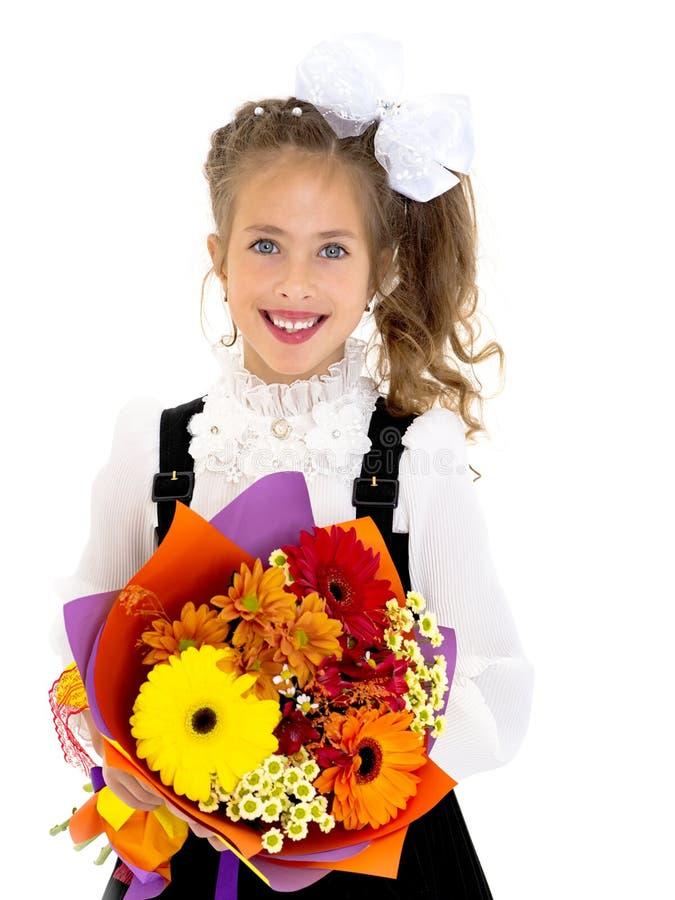 小女孩上有花花束的学  库存照片