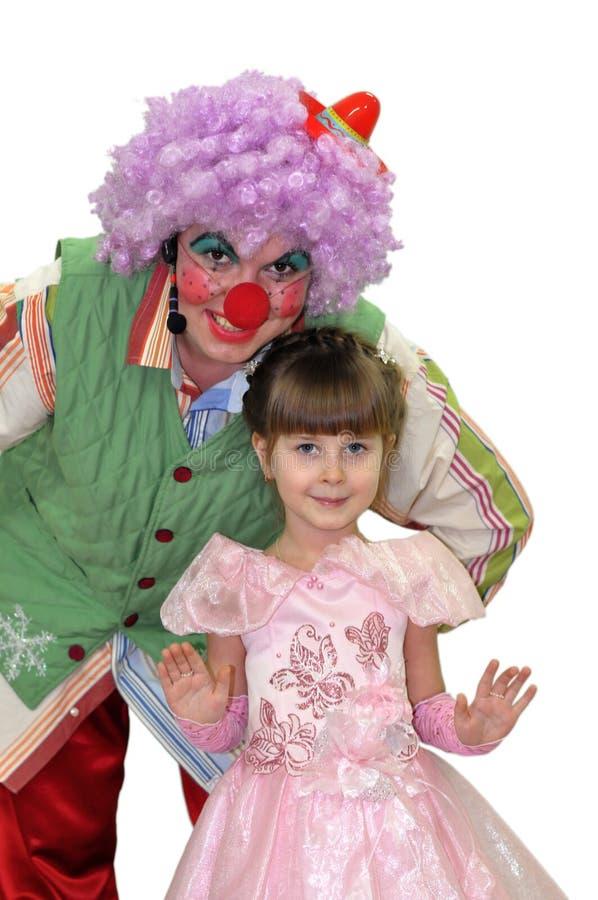 小女孩和小丑。 免版税库存图片