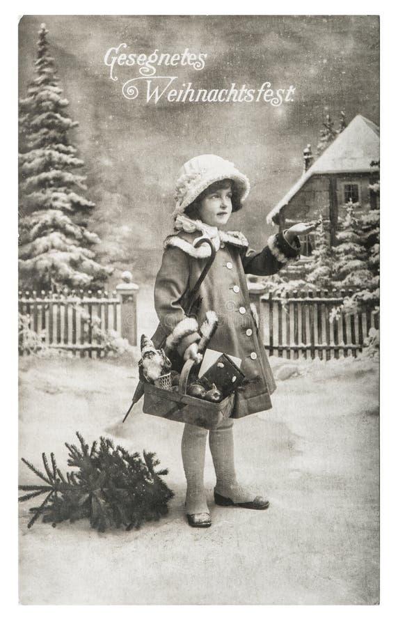小女孩圣诞树礼物葡萄酒玩具 库存照片