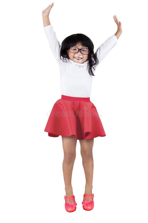 小女孩在演播室跳 库存图片