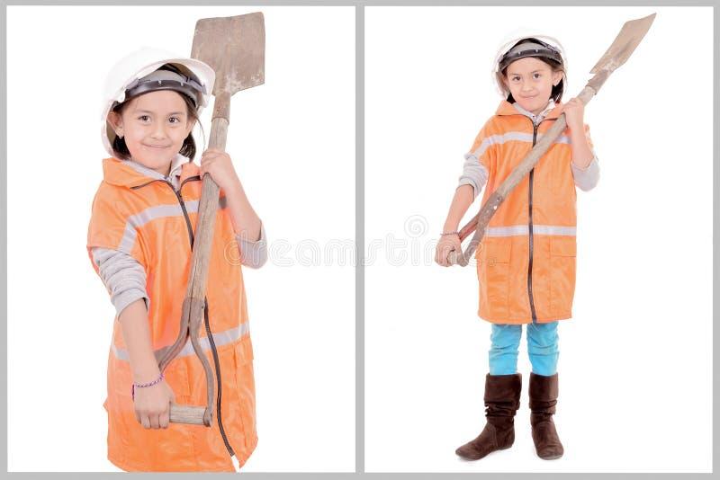 小女孩在建筑给白色穿衣 库存图片