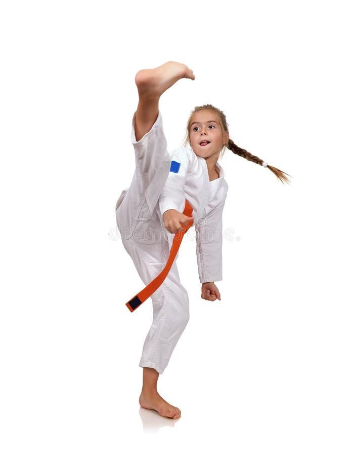 小女孩实践空手道 免版税库存照片