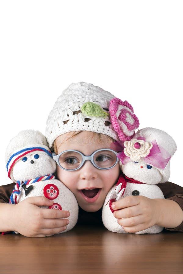 小女孩感觉愉快使用与她的玩偶 库存照片