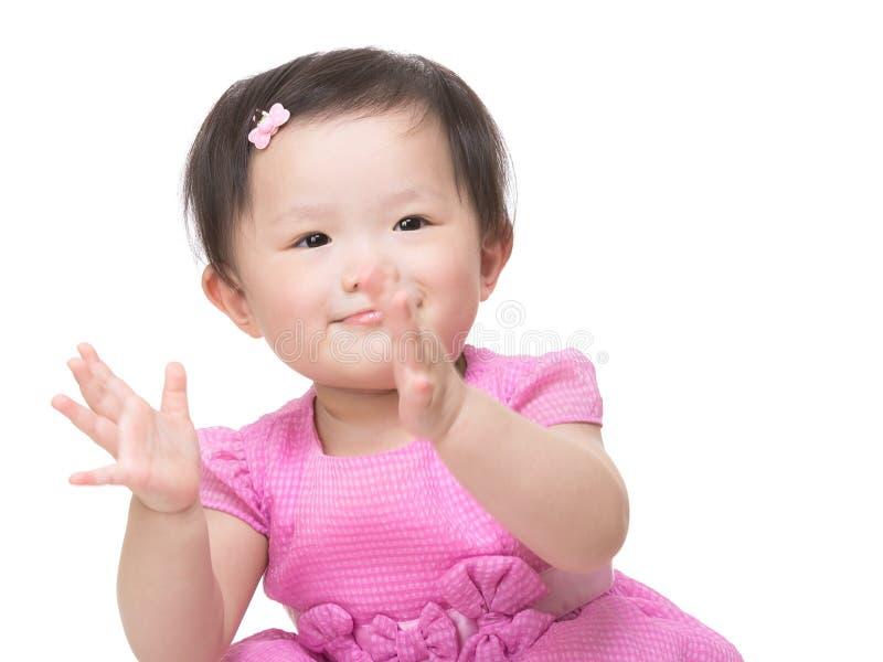小女孩拍的手 库存图片