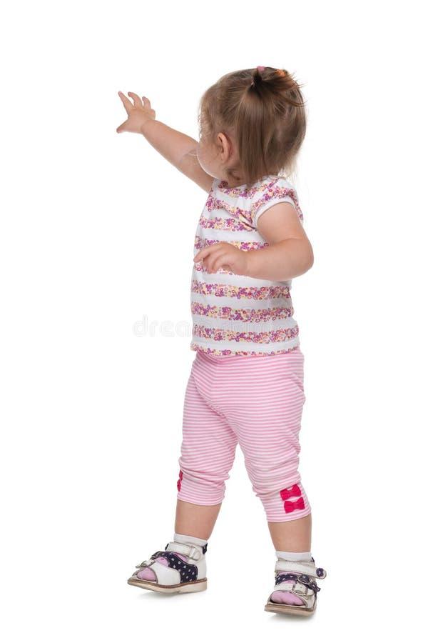 小女孩显示她的手后面 库存照片