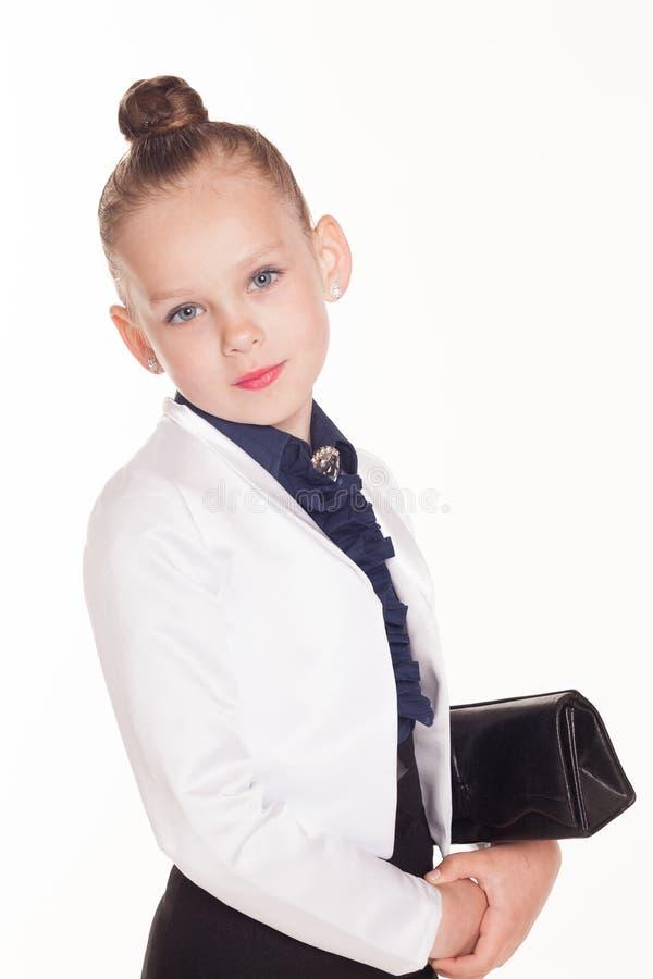 小女孩有袋子的企业夫人 免版税库存照片
