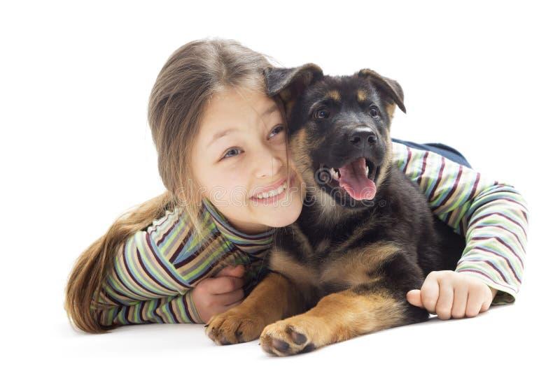 小女孩查寻与小狗 免版税库存照片