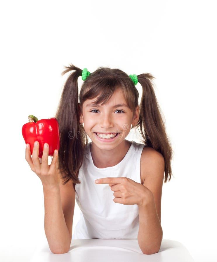 小女孩用红辣椒 库存照片