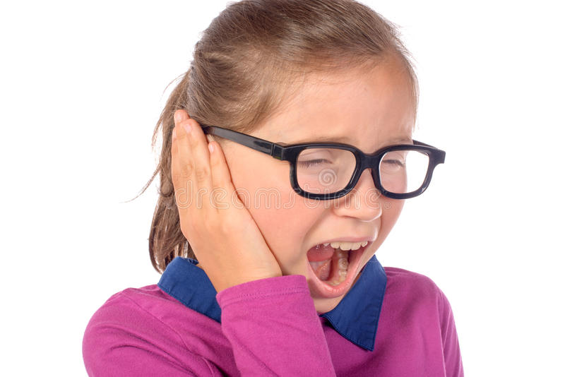 小女孩耳朵痛 免版税库存图片