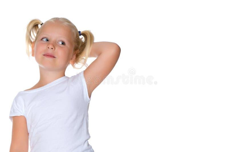 小女孩认为 免版税图库摄影