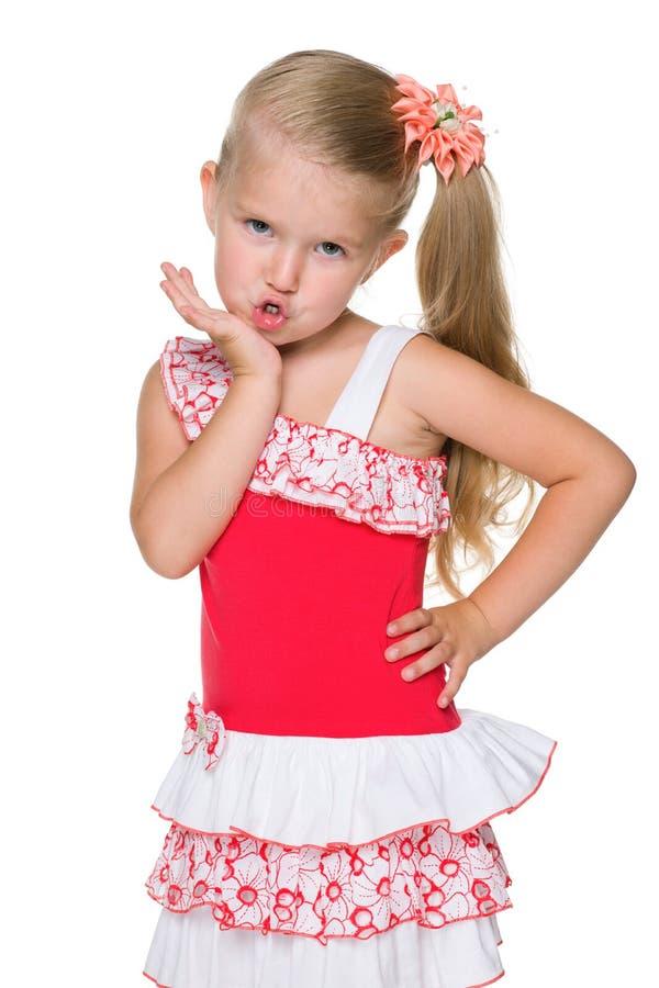小女孩送空气亲吻 免版税图库摄影