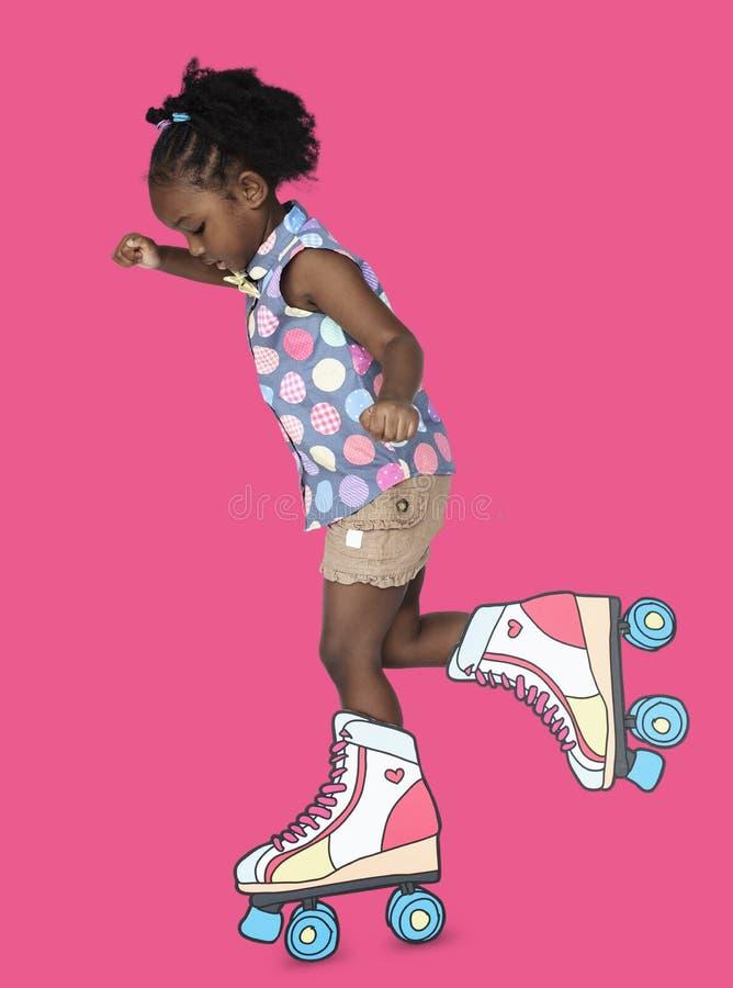 小女孩逗人喜爱滑冰的Papercraft 图库摄影