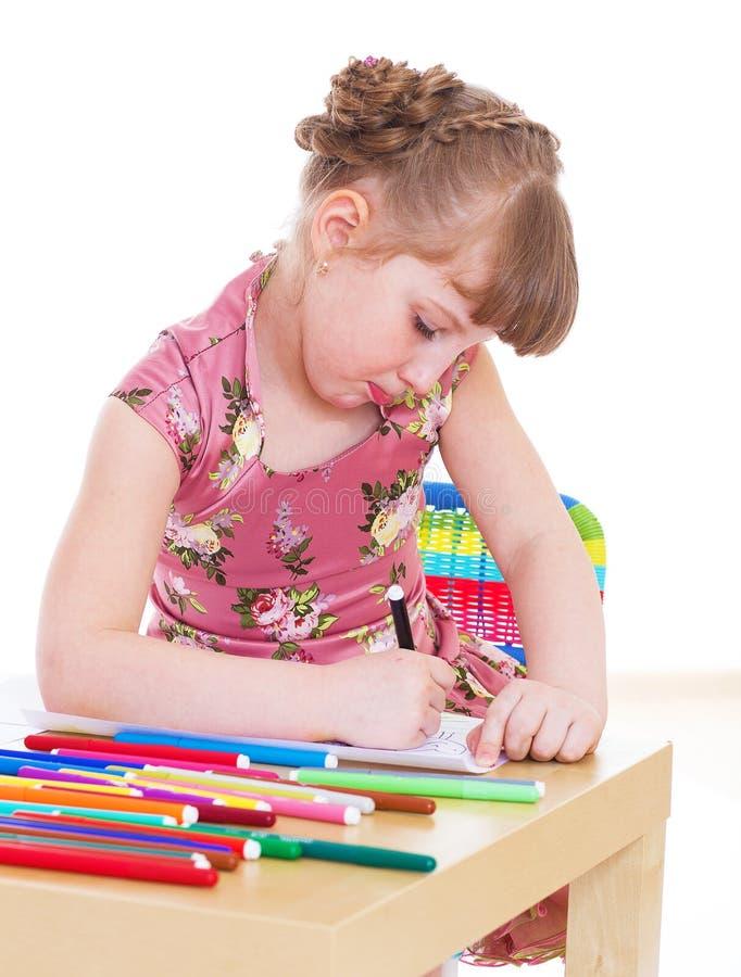 小女孩画与标志 免版税库存照片