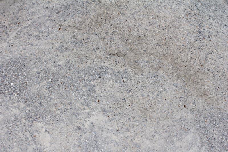 小小卵石和沙子背景  免版税库存图片