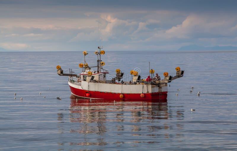 小小船的捕鱼 库存图片