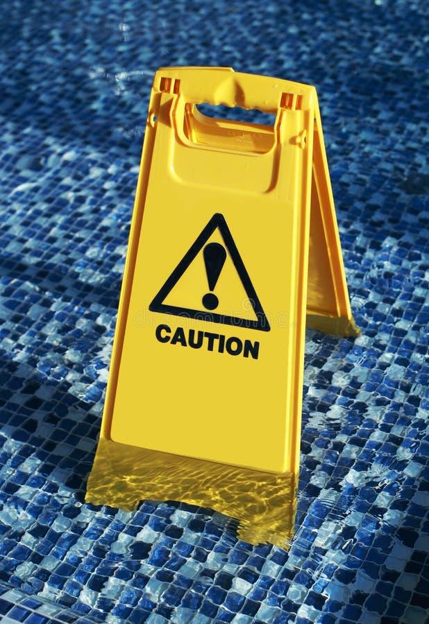 小心湿楼层 库存图片