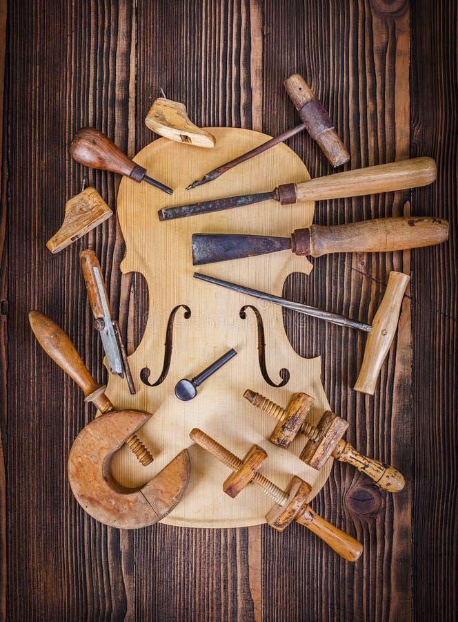 小提琴腹部和工作工具 库存照片