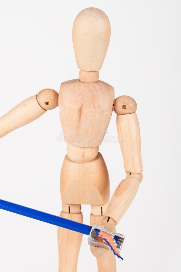 小木时装模特立场削尖在whi隔绝的颜色铅笔 免版税库存照片