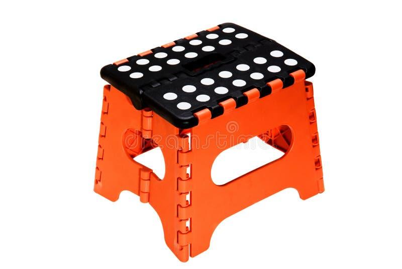 小橙色折叠椅 免版税库存图片