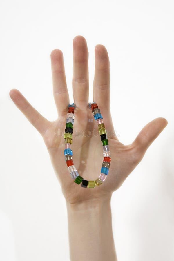 小珠递被塑造的好的妇女 免版税库存照片