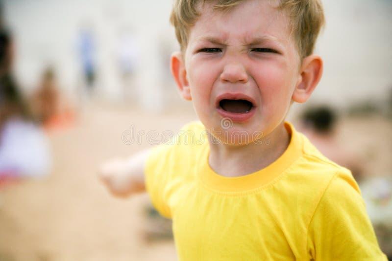 小男孩勃然大怒 库存图片