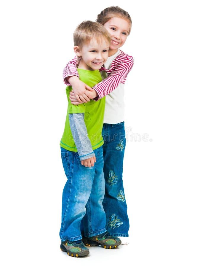 小男孩和他逗人喜爱的姐妹 图库摄影