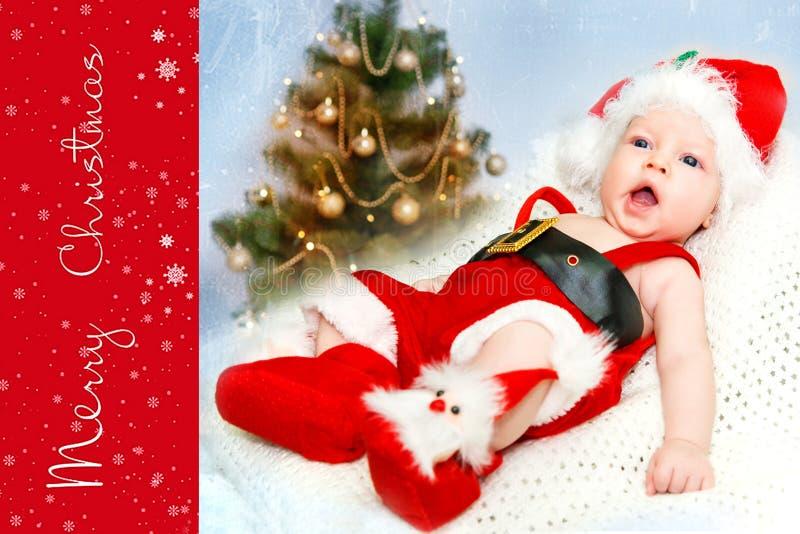 小男孩在圣诞老人帽子 免版税库存图片