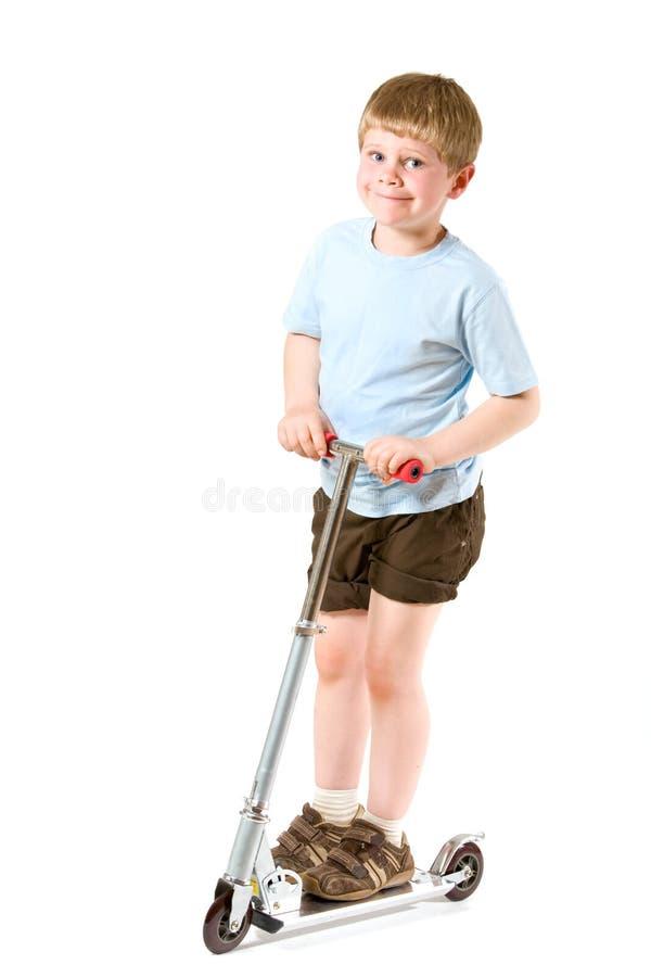 小男孩的滑行车 免版税图库摄影