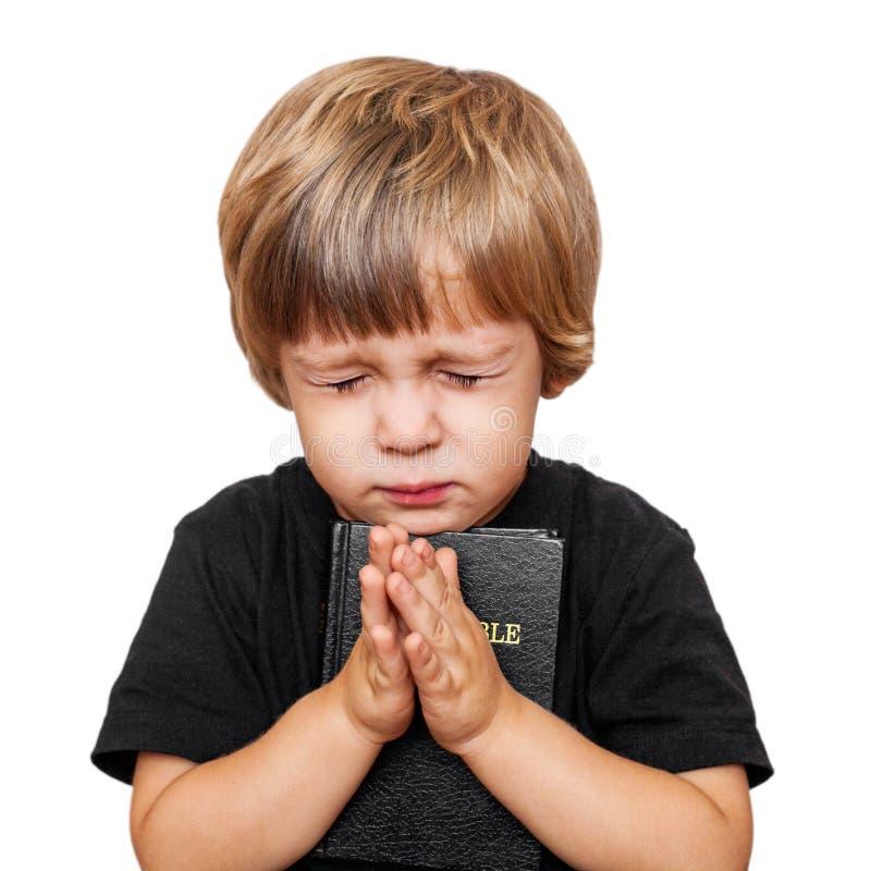 小男孩祈祷 免版税图库摄影