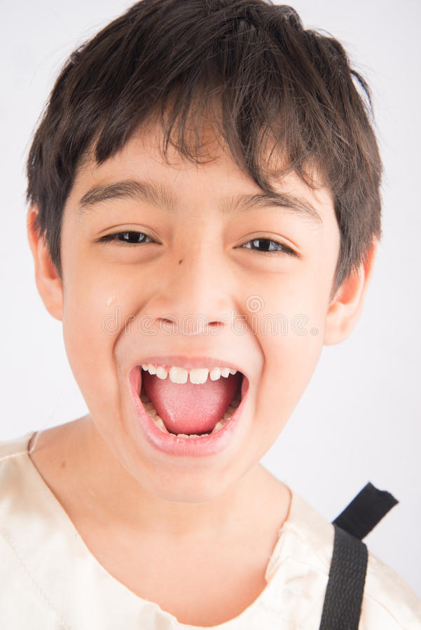 小男孩面孔的笑关闭 库存图片