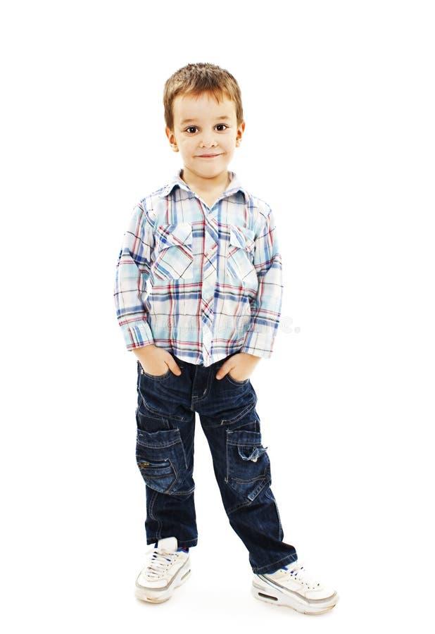 小男孩画象用在口袋的手 免版税图库摄影