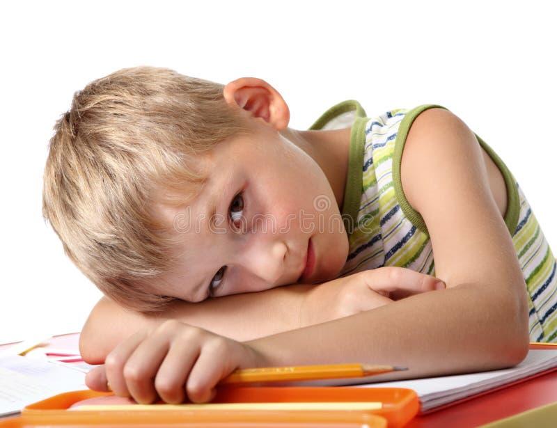小男小学生疲倦了 库存图片