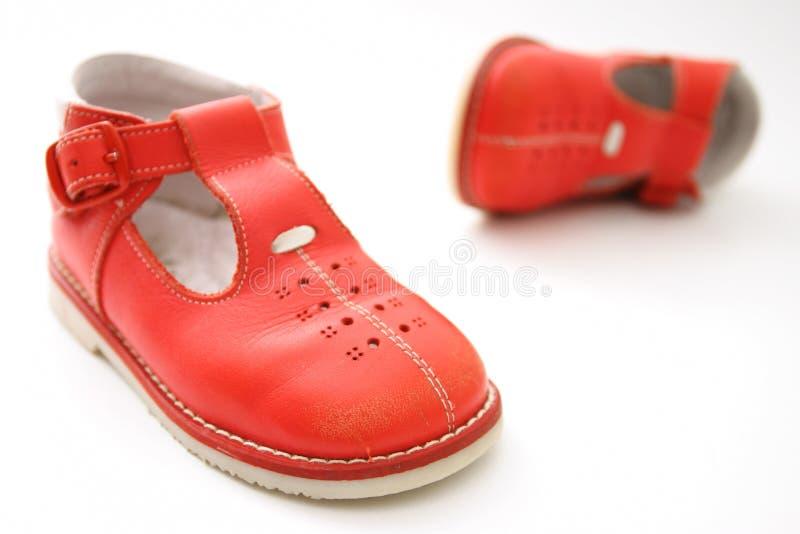 小的红色鞋子 免版税库存照片