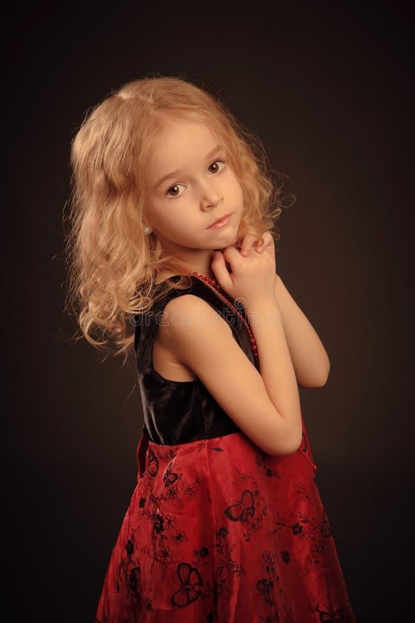 小的镇静女孩纵向 免版税库存图片