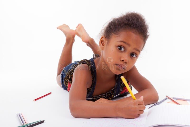 小的非洲亚洲女孩图画 免版税库存照片