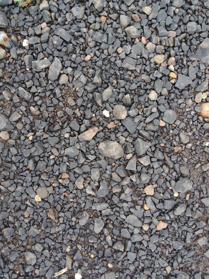 小石头路构造了背景,织地不很细背景墙纸 免版税库存图片