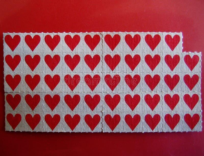 小红色棍子纸背景宏观墙纸小字 免版税库存图片