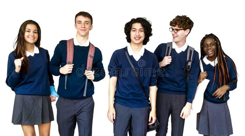 小组不同的高中学生演播室画象 库存照片