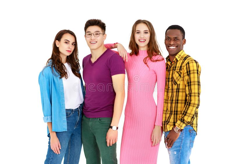 小组快乐的年轻人在白色背景和妇女隔绝的男人 免版税库存图片