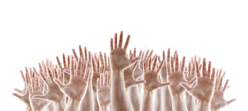 小组有开放棕榈的被举的手 免版税库存图片