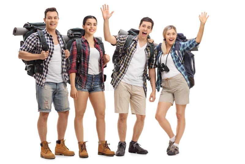小组有背包的快乐的徒步旅行者 免版税图库摄影