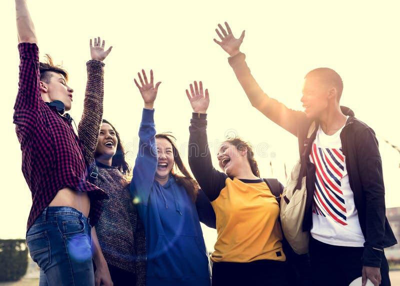 小组朋友胳膊一起培养了支持和配合conce 免版税库存图片
