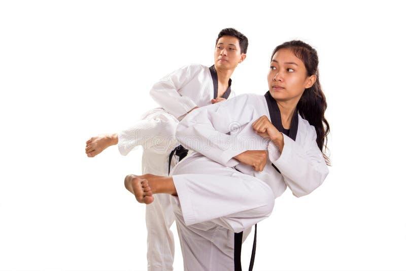 小组跆拳道踢的实践 免版税图库摄影