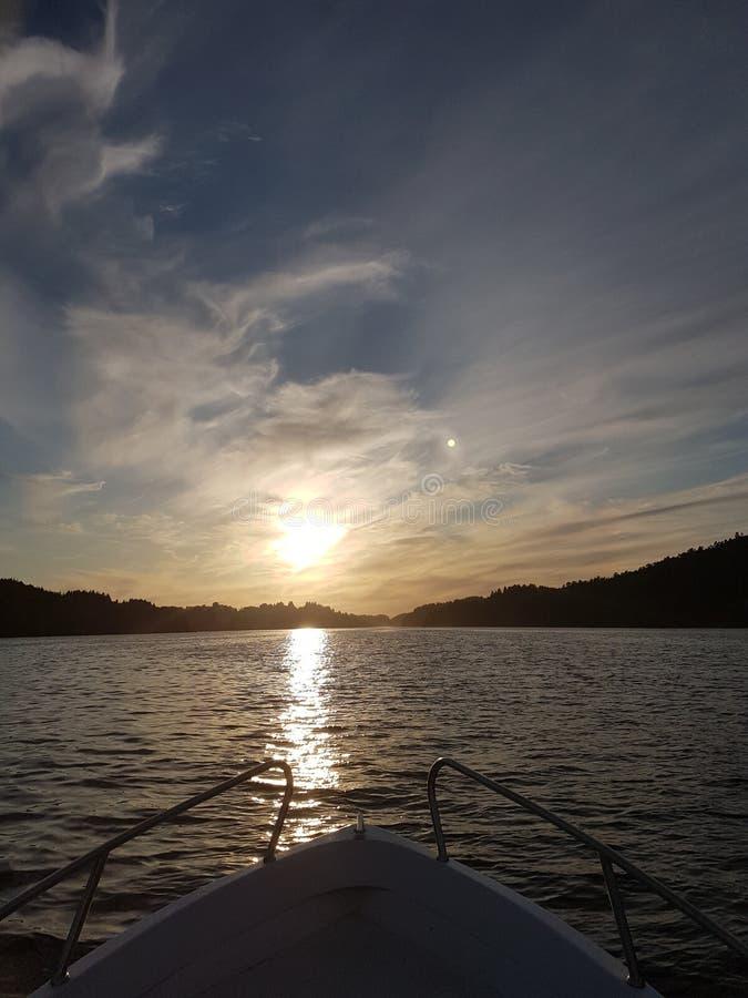 小船日落挪威 图库摄影
